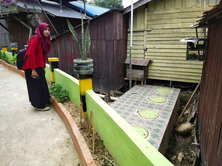 Bangun Jalan Gang diatas Drainase, Pemkab Kukar Sulap Kawasan Kumuh Menjadi Kawasan Yang Instagramable